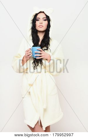 Sexy Girl Posing In Beige Velour Bathrobe With Cup