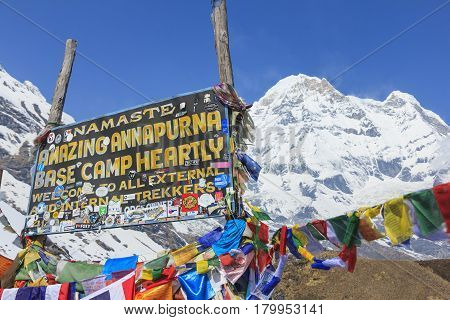 ANNAPURNA NEPAL - APRIL 14 2016 : Himalaya Annapurna South mountain peak with Annapurna base camp sign there is very famous trekking destination in Nepal.