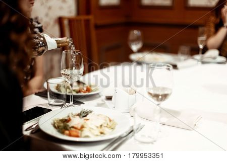 Unusual View Of Waiter Pouring Glasses With Wine Or Champagne At Luxury Celebration, Catering In Res