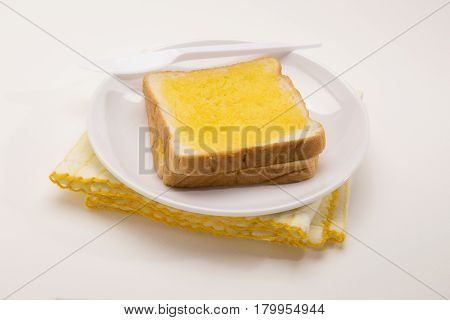 sweet toast butter plate with yellow dish towel decoration on white background. this bread is thai style sweetmeat.