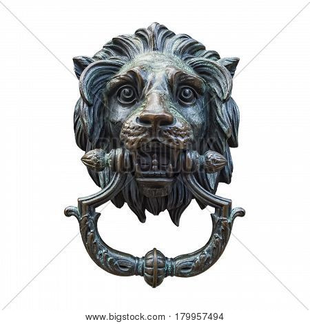 A classic lion head door knocker made out of metal and isolated against a white background.