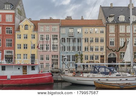 COPENHAGEN DENMARK - DECEMBER 24 2016: Nyhavn district is one of the most famous landmarks in Copenhagen Denmark and always packed with tourists.