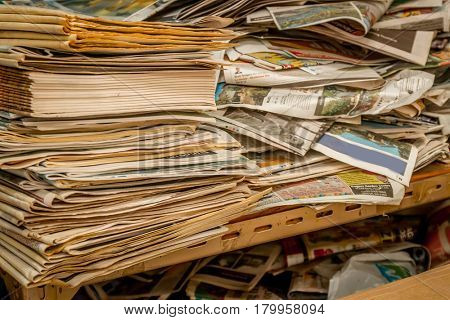 piles and stacks of old papers, newspapers, magazines and books