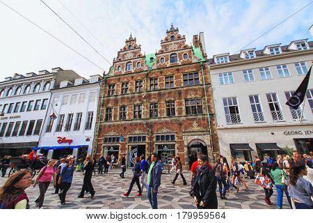COPENHAGEN DENMARK - JUNE 15: Stroget - this popular tourist attraction in the center of town is the longest pedestrian shopping area in Europe in Copenhagen Denmark in 2012