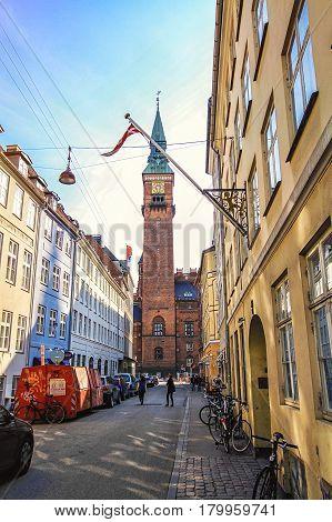 COPENHAGEN DENMARK - JUNE 15: Street with City Hall castle in the Old Town in Copenhagen Denmark in 2012