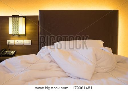White sheet pillow on messy bed decoration in bedroom interior Messy bed concept