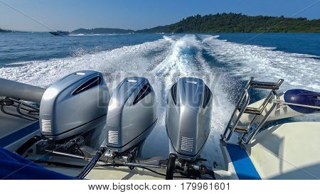 Thailand. Three powerful engines mounted on the speedboat. Andaman Sea.