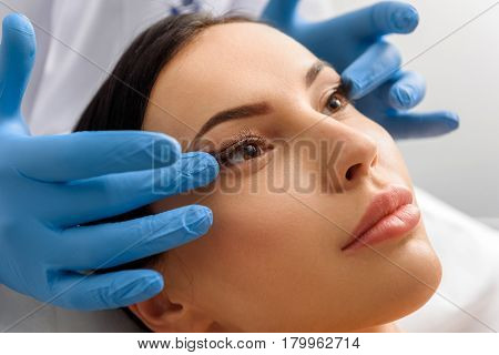 Focus on side view sure woman in beauty salon. Therapeutic removing wrinkles