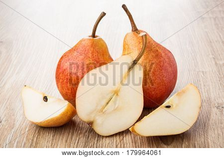 Whole Pears And Pieces Of Red Pears On Table
