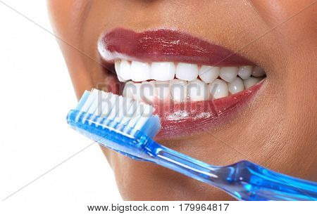 African-American woman with toothbrush.