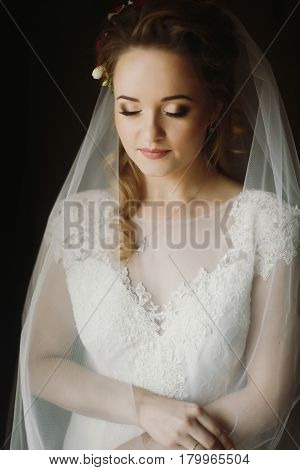 beautiful bride elegant portrait in the morning soft light. sensual look of woman in wedding getting ready ceremony boudoir beautiful photos. gentle atmospheric moment