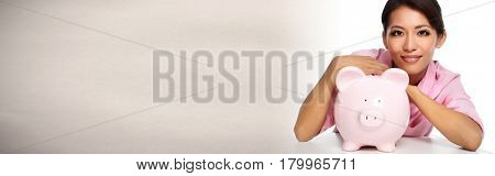 Young asian woman with a piggy bank.