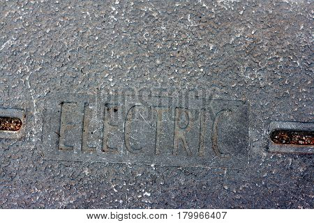 The word ELECTRIC in Capital letters embedded into cement
