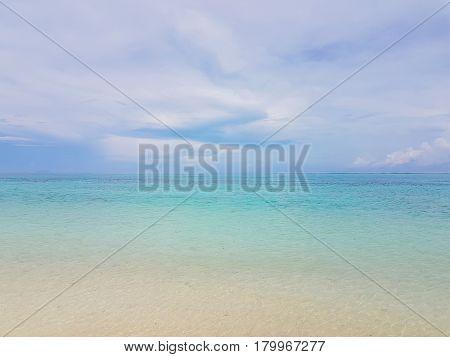 Sunshine on a sea wave at Karon beach Phuket Thailand. Sunny summer sea beach waves. Sunshine sea wave near sandy beach. Tropical island beach relax. Exotic landscape of ocean wave Phuket island