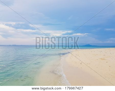 Sunshine on a sea wave at Karon beach Phuket Thailand. Sunny summer sea beach waves. Sunshine sea wave near sandy beach. Tropical island beach relax. Exotic landscape of ocean wave Phuket island