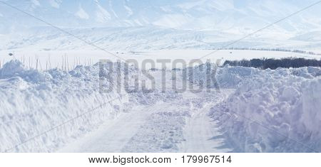 Road in the snow in the foothills .