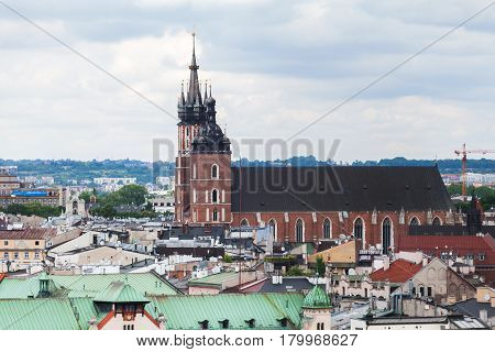Aerial view of the Church of St. Mary in Krakow. Basilica Mariacka. Dramatic sky. Krakow. Poland. Panorama of city