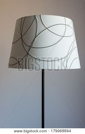 Lamp with a lampshade in a hotel room