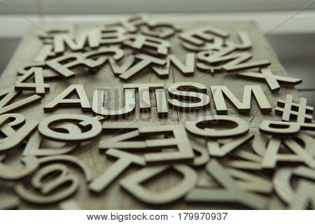 The word Autism spelled out in wood letters