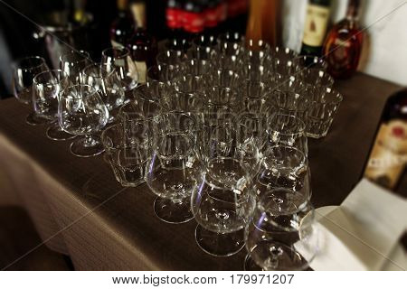 Luxury Crystal Whiskey Whisky Glasses On Dark Wooden Background - Wedding Reception Table Arrangemen