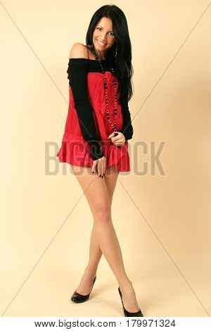 Portrait of a beautiful fashionable girl model in studio in a dress