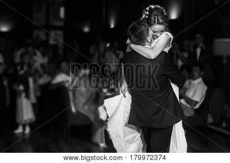 Wedding Couple Performing First Dance And Hugging. Luxury Bride And Groom Embracing. Tender Sensual