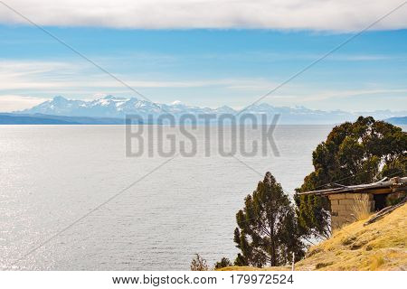 The Majestic Cordillera Real Mountain Range At The Horizon Of The Titicaca Lake. Telephoto View From