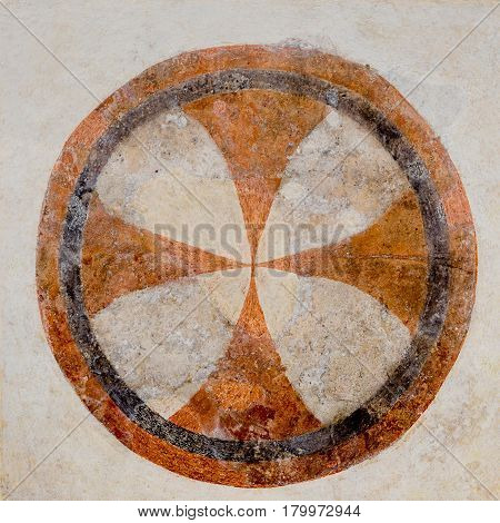 Consecration Cross enclosed within a circle a medieval fresco in Skibby church Denmark - February 21 2017