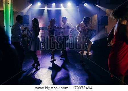 Fun Dance Party At Nightclub After Wedding Reception, Guests And Friends Dancing On The Floor Night