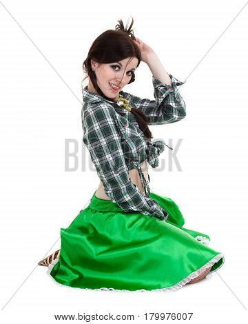 Sexy young woman dressed in shirt and skirt posing, isolated on white background in full length.