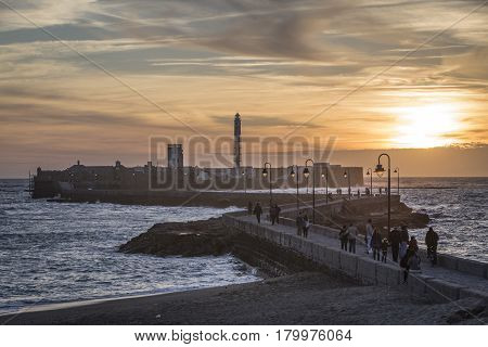 Castle of San Sebastian at sunset fortress on a smail island separated from the main city according classical tradition there was a Temple of Kronos cultural landmark of the city Cadiz Spain