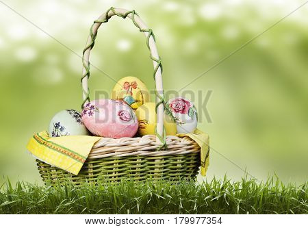 basket with Easter eggs on a green background.