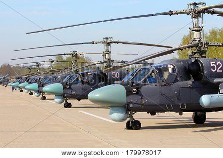 KUBINKA, MOSCOW REGION, RUSSIA - MAY 9, 2015: Line of Kamov Ka-52 helicopters preparing for Victory Day parade at Kubinka air force base.