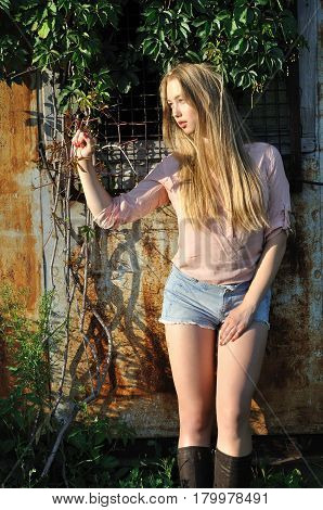 portrait of teenage girl on rustic background in summer day