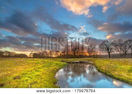 Sunset Over River Landscape