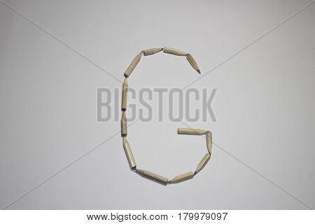 Alphabet symbol - letter G pencil on white background