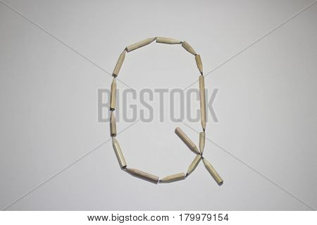 Alphabet symbol - letter Q pencil on white background