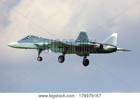 ZHUKOVSKY, MOSCOW REGION, RUSSIA - JULY 12, 2014: Sukhoi T-50 prototype PAK-FA 055 BLUE is a brand new fifth generation jet fighter shown while perfoming a test flight at Zhukovsky airport.