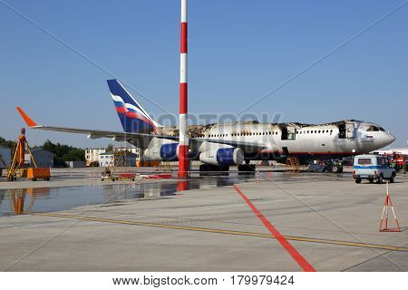 SHEREMETYEVO, MOSCOW REGION, RUSSIA - JUNE 3, 2014: Ilyushin IL-96-300 caught fire while standing at Sheremetyevo international airport, Moscow region, Russia.