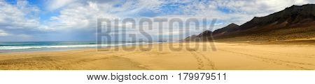 View on the beach Cofete on the Canary Island Fuerteventura Spain. Panorama format.