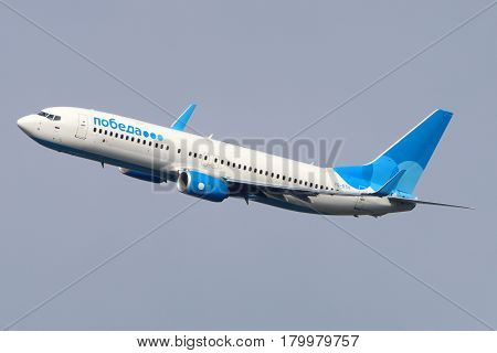 VNUKOVO, MOSCOW REGION, RUSSIA - JULY 23, 2015: Pobeda Boeing 737-800 makes final turn to land at Vnukovo international airport.
