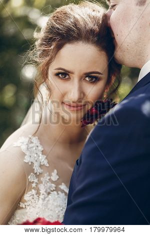 Beautiful Brunette Bride Portrait Face Close-up, Sensual Groom Kissing Hugging Bride, Newlywed Coupl