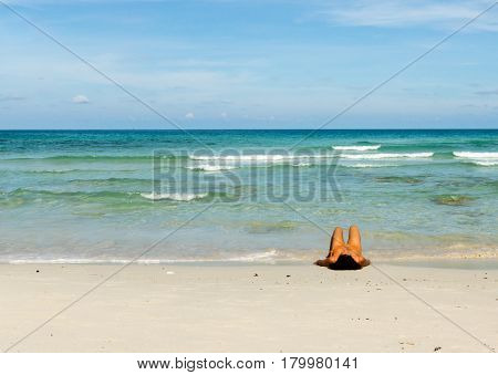 Woman resting on a white beach among the waves Koh Phangan Thiland - May 5 2016