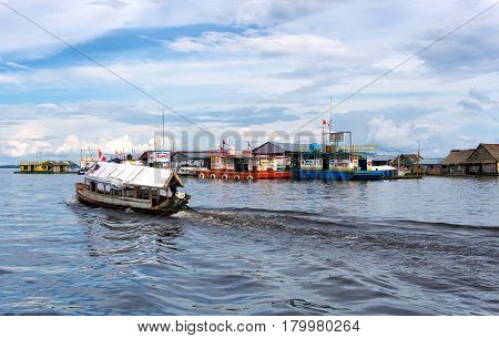IQUITOS PERU - MARCH 17: Floating shops in Iquitos Peru on March 17 2015
