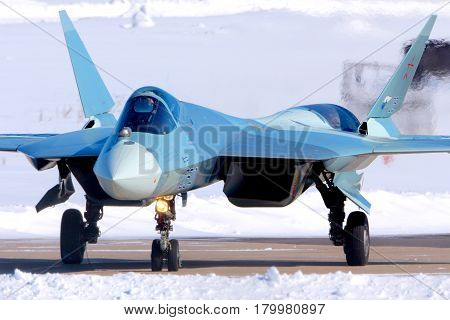 ZHUKOVSKY, MOSCOW REGION, RUSSIA - MARCH 27, 2013: Sukhoi T-50 prototype PAK-FA 054 BLUE is a brand new fifth generation jet fighter shown while perfoming a test flight at Zhukovsky airport.