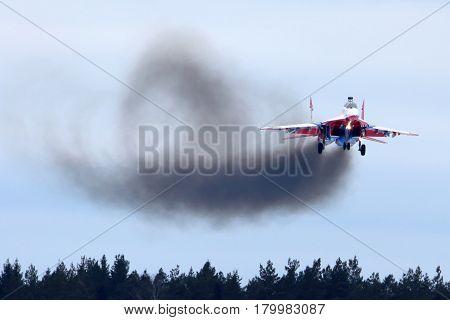 KUBINKA, MOSCOW REGION, RUSSIA - FEBRUARY 24, 2014: MiG-29UB jet fighter performing go around exercise at Kubinka air force base.