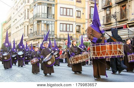 Madrid,Spain- April 11,2009 : Members of a catholic brotherhood march during a procession in MadridSpain during Easter