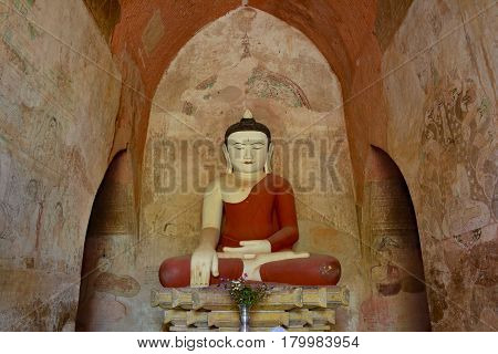 Beautiful Buddha Statue Inside Buddhist Temple With Old Frescos On The Walls. Bagan, Myanmar.