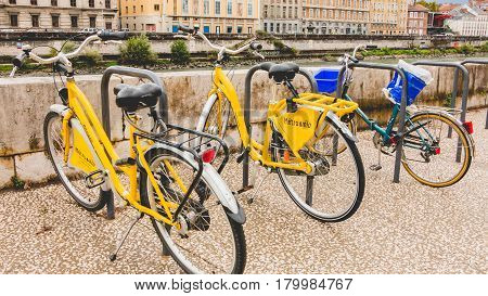 Grenoble France - September 17 2016 : Shared bikes are lined up in the streets of Grenoble France. The successful Metrovelo service launched in 2004 has over 800 stations and 4000 bikes throughout Grenoble