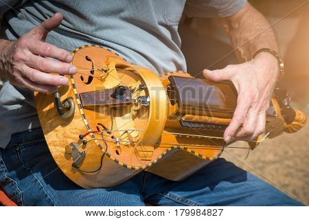 Hurdy Gurdy Man player ioutdoor street city